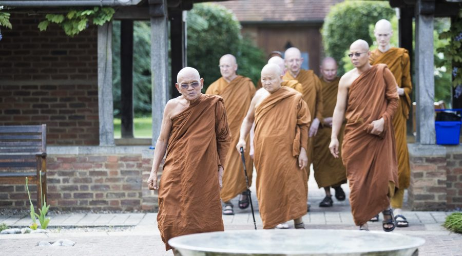 Monks entering the temple courtyard